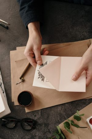 person-holding-white-printer-paper-3826684